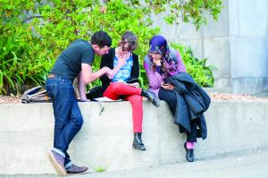 Three students working together image